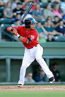 Shortstop Mauricio Dubon (10) of the Greenville Drive bats in a game against the Charleston RiverDogs on Saturday, May 23, 2015, at Fluor Field at the West End in Greenville, South Carolina. Dubon is the No. 23 prospect of the Boston Red Sox, according to Baseball America. Charleston won 5-4. (Tom Priddy/Four Seam Images)