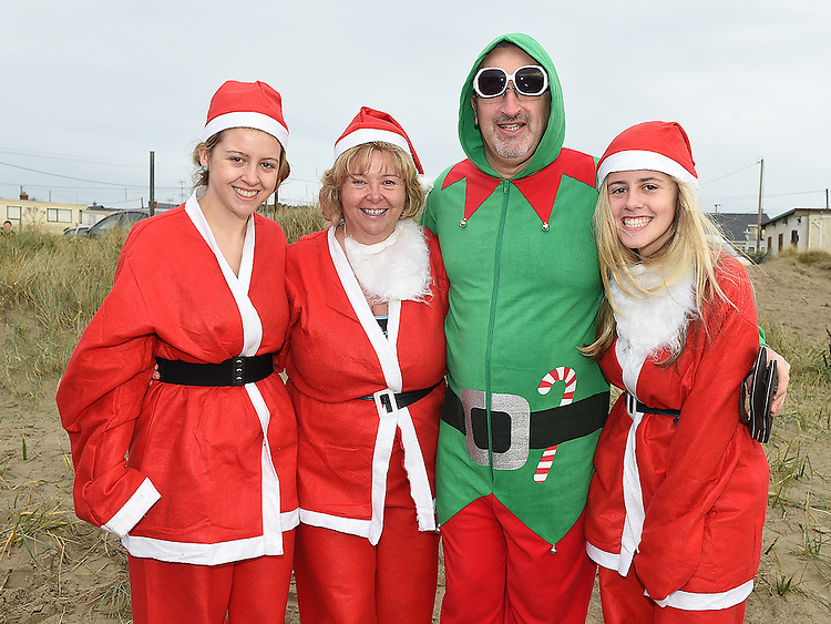 Senator Mary Moran with her daughters Tara and Dearbhla and Fr Michael Cussack who took part in the Polar Plunge at Clogherhead Beach in aid of the Special Olympics. Photo:Colin Bell/pressphotos.ie
