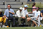 20 September 2009: North Carolina's Nikki Washington (26), who was injured in the team's game two days earlier, watches the game with the coaching staff. From left: head coach Anson Dorrance, Bill Palladino, and Chris Ducar. The University of North Carolina Tar Heels played the Auburn University Tigers to a 0-0 tie after overtime at Koskinen Stadium in Durham, North Carolina in an NCAA Division I Women's college soccer game.