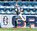 Dundee's Stephen McGinn (48) celebrates  after he scores their equalising goal.
