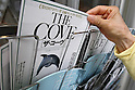 July 3, 2010 - Tokyo, Japan - A pedestrian takes a pamphlet of the Oscar-winning dolphin hunting documentary 'The Cove' near cinema running the movie in Tokyo, Japan, on July 3, 2010. Despite pressure from groups who say the film is anti-Japanese, 'The Cove' will be shown at six theaters in Tokyo and five other Japanese cities beginning Saturday, followed by Nagoya Cinematheque and 15 other theaters across Japan from Aug. 14.