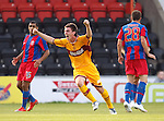 Ross Forbes celebrates after his long range shot goes in to give Motherwell the lead