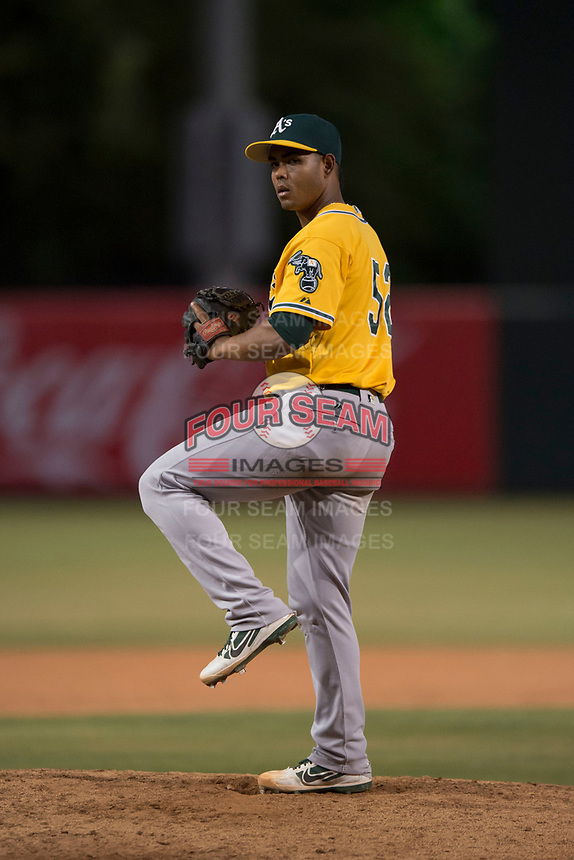 AZL Athletics relief pitcher Jesus Monserratt (52) delivers a pitch during an Arizona League game against the AZL Angels at Tempe Diablo Stadium on June 26, 2018 in Tempe, Arizona. The AZL Athletics defeated the AZL Angels 7-1. (Zachary Lucy/Four Seam Images)