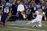 Annapolis, MD - December 28, 2015:    Navy Midshipmen running back Dishan Romine (28) gets tackled  during the Military Bowl game between Pitt vs Navy at Navy-Marine Corps Memorial Stadium in Annapolis, MD. (Photo by Elliott Brown/Media Images International)
