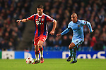 Fernando of Manchester City chases Xabi Alonso of Munich - Manchester City vs. Bayern Munich - UEFA Champion's League - Etihad Stadium - Manchester - 25/11/2014 Pic Philip Oldham/Sportimage
