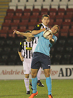 Lewis Morgan climbs above Stephen Husband in the St Mirren v Dunfermline Athletic Scottish Professional Football League Under 20 match played at the Excelsior Stadium, Airdrie on 11.12.13.