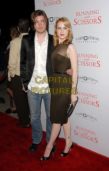 "EVAN RACHEL WOOD & IRA .attends The TrisStar Pictures' World Premiere of ""Running with Scissors"" held at The Academy of Motion Pictures Arts & Sciences in Beverly Hills, California, USA, October 10th 2006..full length olive green dress .Ref: DVS.www.capitalpictures.com.sales@capitalpictures.com.©Debbie VanStory/Capital Pictures"