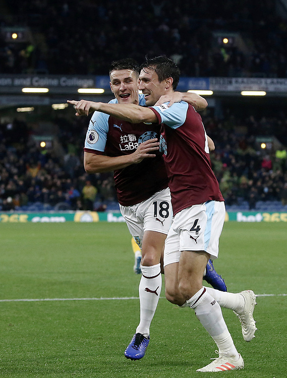 Burnley's Jack Cork (No.4) celebrates with team-mate Burnley's Ashley Westwood as he celebrates after his shot was put over the line by James Tarkowski to score his sides opening goal<br /> <br /> Photographer Rich Linley/CameraSport<br /> <br /> The Premier League - Burnley v Brighton and Hove Albion - Saturday 8th December 2018 - Turf Moor - Burnley<br /> <br /> World Copyright © 2018 CameraSport. All rights reserved. 43 Linden Ave. Countesthorpe. Leicester. England. LE8 5PG - Tel: +44 (0) 116 277 4147 - admin@camerasport.com - www.camerasport.com