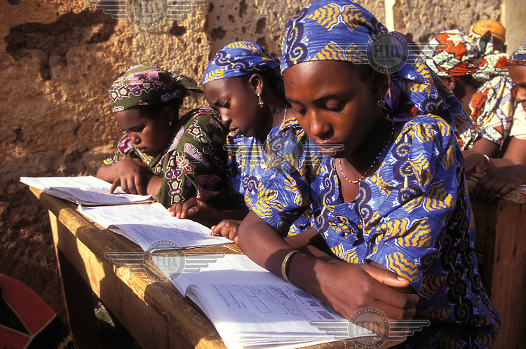 © Giacomo Pirozzi / Panos Pictures..Northern CAMEROON..Girls learning French at a community school.