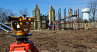City workers attach platforms to newly installed metal posts at Planet Westerville as the original wooden playground is replaced with a metal structure that promises to be more durable and safe. Photo Copyright Gary Gardiner. Not be used without written permission detailing exact usage.