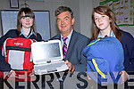 NO MORE BAGS: Principal of St Joseph's Secondary School in Ballybunion with one of the new Fizzbooks which will replace schoolbags for first year students at the school in September, pictured here with student Ciara Keane and Maebh Ferriter.