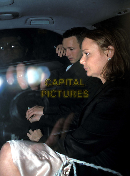 STELLA McCARTNEY..Stella McCartney leaving Vogue's 10th anniversary party at the Ritz last night hand in hand with a mystery man..in car..www.capitalpictures.com..sales@capitalpictures.com..©Capital Pictures..half length, half-length