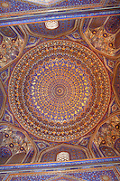 Detail of ceiling decoration, Tillyah-Kori Madrasah, 1646-60, Registan, Samarkand, Uzbekistan, pictured on July 15, 2010, in the morning. The Tillyah-Kori (gilded) Madrasah is part of the Registan Ensemble, surrounding a magnificent square. Commissioned by Yalangtush Bakhadur it is not only a school but also the grand mosque whose lavishly gilded main hall in Kundal style justifies the name. Samarkand, a city on the Silk Road, founded as Afrosiab in the 7th century BC, is a meeting point for the world's cultures. Its most important development was in the Timurid period, 14th to 15th centuries. Picture by Manuel Cohen.