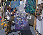 Artist Bruce Lee Phunzjun paints during Art Fest on Saturday June 30, 2018 in downtown Reno.
