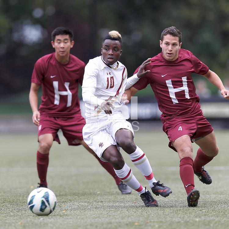 Boston College midfielder Derrick Boateng (10) dribbles as Harvard University defender Ross Friedman (4) defends.Boston College (white) defeated Harvard University (crimson), 3-2, at Newton Campus Field, on October 22, 2013.