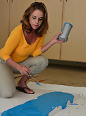 Stock photo of woman painting