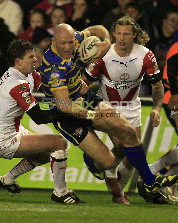 Pix: Chris Mangnall/SWpix.com, Rugby League, Super League. 20/03/09  St Helens Saints v Leeds Rhinos ....picture copyright>>Simon Wilkinson>>07811267 706>>....St Helens's Matt Gidley and Sean Long tackle Leeds's Keith Senior
