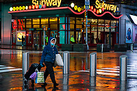 NEW YORK, NY - April 13:  A woman wearing a face mask walks around Times Square during a rainy day on April 13, 2020. in New York, United States. The global economy is facing the worst collapse since the WWII, while COVID-19  pandemic has now killed more than 22,000 people in the United States and at least 1,864,629 people died world wide.  (Photo by Eduardo MunozAlvarez/VIEWpress)
