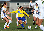 SIOUX FALLS, SD - NOVEMBER 7:  Julia Lam #27 from SDSU passes the ball around a trio of defenders including Roxy Roemer #4 and Meghan Johnston #12 from NDSU in the second half of the Summit League Championship Soccer match Saturday at Fischback Soccer Field in Brookings. (Photo by Dave Eggen/Inertia)