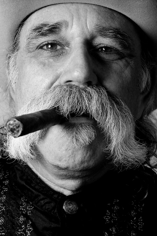 cowboy 7/25/09- Bill Tomczak, 57, of Tempe, participated in  Saturday's Wyatt Earp-Holliday Mustache Contest held at the Goldfield Ghost Tow in Apache Junction. The contest was held during their celebration for National Day of the Cowboy. (Pat Shannahan/ The Arizona Republic)