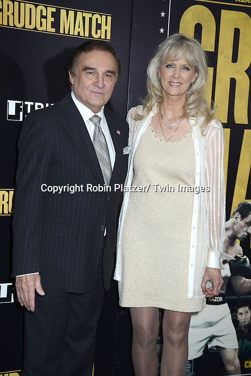 "Tony Lo Bianco and Alyse Muldoon attend the World Premiere of ""Grudge Match"" at the Ziegfeld Theatre in New Yok City on December 16, 2013."
