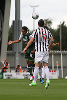 Aerial battle with Jorge Claros (left) Kenny McLean and Paul McGowan (hidden) in the St Mirren v Hibernian Clydesdale Bank Scottish Premier League match played at St Mirren Park, Paisley on 18.8.12.