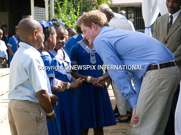 "PRINCE HARRY_.meets young children who put on a performance entitled ""Dance In Africa"", at the Garrison Museum, Barbados. Prince Harry is on a 3-day  Royal Tour of Barbados_30/01/2010.Mandatory Credit Photo: ©DIAS-NEWSPIX INTERNATIONAL..**ALL FEES PAYABLE TO: ""NEWSPIX INTERNATIONAL""**..IMMEDIATE CONFIRMATION OF USAGE REQUIRED:.Newspix International, 31 Chinnery Hill, Bishop's Stortford, ENGLAND CM23 3PS.Tel:+441279 324672  ; Fax: +441279656877.Mobile:  07775681153.e-mail: info@newspixinternational.co.uk"
