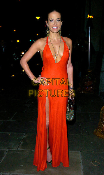SOPHIE ANDERTON.The La Dolce Vita gala, The Old Billingsgate Market, London, UK..December 11th, 2006.full length red dress plunging neckline slit split cleavage hand on hip.CAP/CAN.©Can Nguyen/Capital Pictures