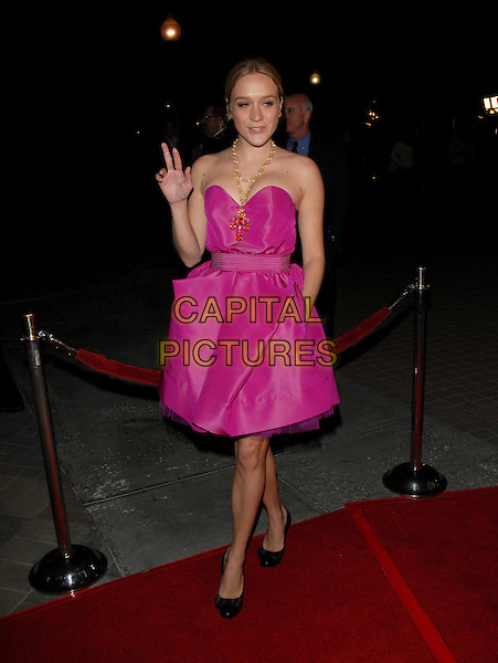 "CHLOE SEVIGNY.The Paramount Pictures L.A Premiere of ""Zodiac"" held at Paramount Studios in Hollywood, California, USA..March 1st, 2007.full length pink dress hand in pocket strapless gold necklace black shoes waving .CAP/DVS.©Debbie VanStory/Capital Pictures"