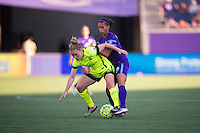 Orlando, Florida - Sunday, May 8, 2016: Seattle Reign FC midfielder Kim Little (8) is pushed over by Orlando Pride defender Kristen Edmonds (12) during a National Women's Soccer League match between Orlando Pride and Seattle Reign FC at Camping World Stadium.