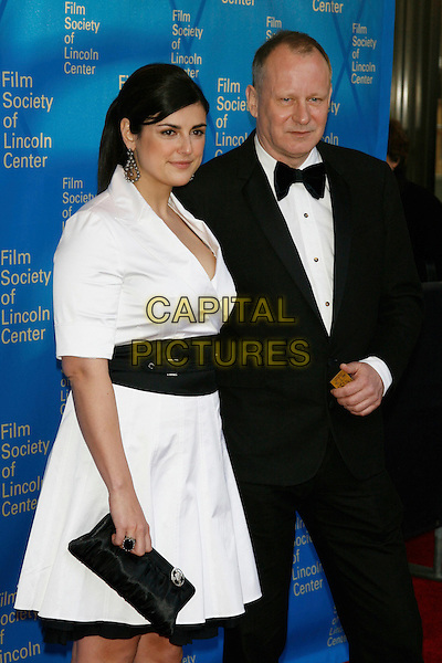 STELLAN SKARSGARD & guest .Film Society of Lincoln Center's 35th Annual Gala Tribute honoring  Meryl Streep at Avery Fisher Hall - Lincoln Center, New York, NY, USA, .April 14, 2008..half length white dress black waistband holding hands suit bow tie .CAP/LNC/TOM .©LNC/Capital Pictures