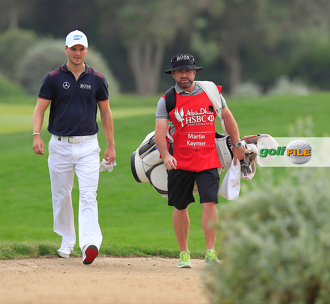 Martin Kaymer (GER) and caddy Craig Connolly in trouble with his drive on the 13th hole during Sunday's Final Round of the Abu Dhabi HSBC Golf Championship 2015 held at the Abu Dhabi Golf Course, United Arab Emirates. 18th January 2015.<br /> Picture: Eoin Clarke www.golffile.ie