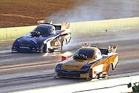 Oct 17, 2015; Ennis, TX, USA; NHRA funny car driver Del Worsham (near) races alongside Jack Beckman during qualifying for the Fall Nationals at the Texas Motorplex. Mandatory Credit: Mark J. Rebilas-USA TODAY Sports