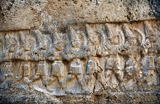 Sculpture of the twelve gods of the underworld from the 13th century BC Hittite religious rock carvings of Yazılıkaya Hittite rock sanctuary, chamber B,  Hattusa, Bogazale, Turkey.