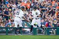 Mikie Mahtook (15) of the Detroit Tigers slaps hands with third base coach Dave Clark (25) after hitting a home run against the Chicago White Sox at Comerica Park on June 2, 2017 in Detroit, Michigan.  The Tigers defeated the White Sox 15-5.  (Brian Westerholt/Four Seam Images)
