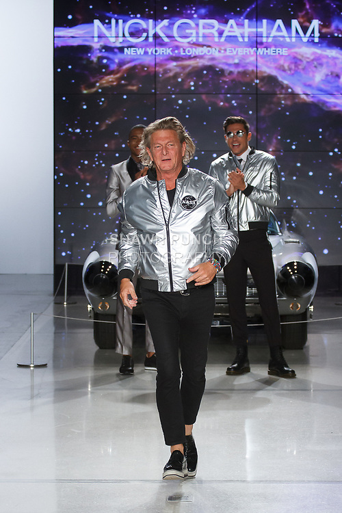 "Fashion designer Nick Graham walks runway at the close of his Nick Graham Spring Summer 2019 ""1969"" collection in at Cadillac House in New York City on July 10, 2018; during New York Fashion Week: Men's Spring Summer 2019."