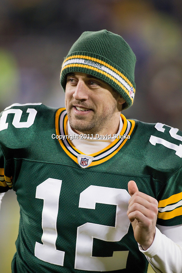 Green Bay Packers quarterback Aaron Rodgers (12) runs off the field after a week 16 NFL football game against the Chicago Bears on December 25, 2011 in Green Bay, Wisconsin. The Packers won 35-21. (AP Photo/David Stluka)