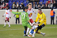 New York Red Bulls goalkeeper Greg Sutton (24) makes a save on Fredy Montero (17) of the Seattle Sounders during the second half. The New York Red Bulls defeated the Seattle Sounders 1-0 during a Major League Soccer (MLS) match at Red Bull Arena in Harrison, NJ, on March 19, 2011.