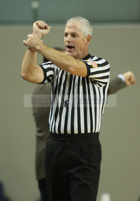 A referee calls a holding foul during the second half of UK hoops vs Eckerd College at Memorial Coliseum in Lexington, Ky., on Sunday, November 3, 2013. Photo by Eleanor Hasken | Staff