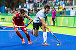 Manuel Brunet #24 of Argentina protects the ball from Elliot van Strydonck #29 of Belgium during Argentina vs Belgium  in the men's gold medal game at the Rio 2016 Olympics at the Olympic Hockey Centre in Rio de Janeiro, Brazil.
