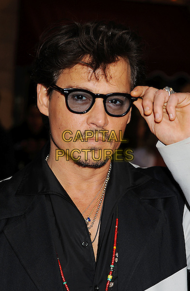 "JOHNNY DEPP .Premiere of ""Pirates of the Caribbean : On Stranger Tides"" held at Disneyland in Anaheim, California, USA, May 7th 2011.4 four portrait headshot glasses black shirt necklaces facial hair moustache mustache goatee red beads hand tinted sunglasses shades.CAP/ROT/TM.© TM/Roth/Capital Pictures"