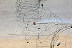 An Israeli CS gas grenade used to disperse protesters during a demonstration against Israel's controversial separation barrier in the West Bank town of Beit Jala near Bethlehem on 04/07/2010.