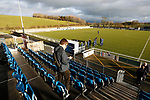 An early arriver on his phone as Hebburn players inspect the pitch. Penrith AFC V Hebburn Town, Northern League Division One, 22nd December 2018. Penrith are the only Cumbrian team in the Northern League. All the other teams are based across the Pennines in the north east.<br />