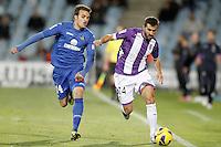 Getafe's Pedro Leon (l) and Real Valladolid's Mikel Balenziaga during La Liga match.November 18,2012. (ALTERPHOTOS/Acero)