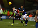 Caolan Lavery of Sheffield Utd and Darnell Furlong of Swindon Town during the English League One match at Bramall Lane Stadium, Sheffield. Picture date: December 10th, 2016. Pic Simon Bellis/Sportimage