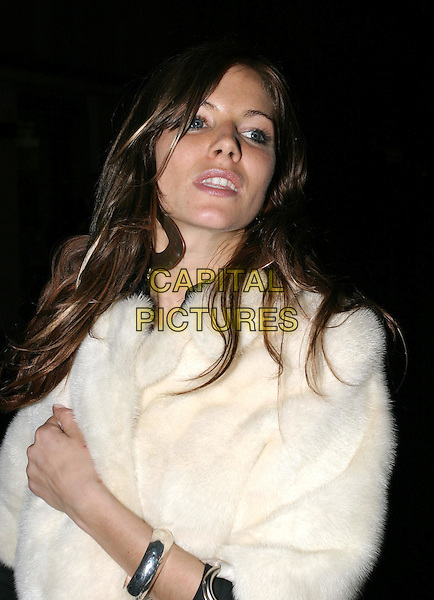 SIENNA MILLER.leaving Gypsy Of Chelsea gala performance at the Royal Court Theatre, Sloane Square.15 March 2004.fur jacket, silver bangle bracelet.www.capitalpictures.com.sales@capitalpictures.com.© Capital Pictures.