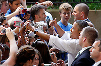 President Barack Obama greets supporters after giving a speech during a campaign stop at the nTelos Wireless Pavilion in Charlottesville, VA.