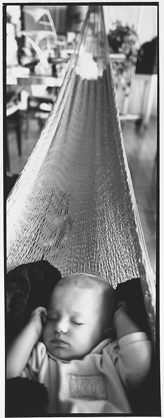Lucas 7 months old asleep in the hammoc at 304 boerum st, East Williamsburg Brooklyn. 10-00 New York