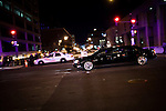 The presidential motorcade drives through Washington, DC on the eve of the inauguration, January 20, 2013.