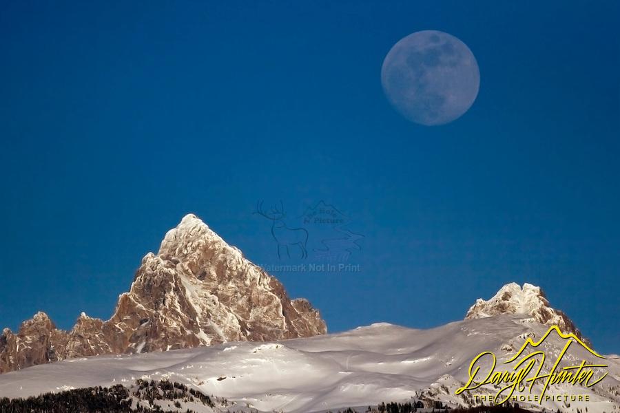 Full Moon Over Grand Tetons on winter evening